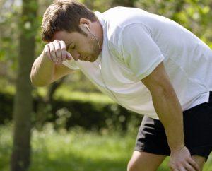 corredor sentindo tontura durante a corrida